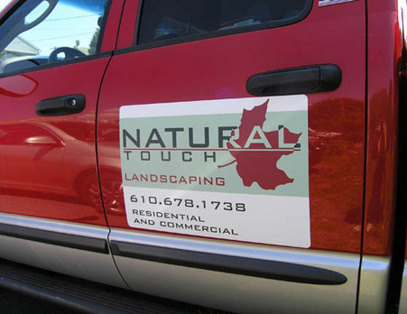 Magnetic sign for landscaping company
